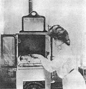 Old School Incubator...I think that is a wood stove on the bottom.